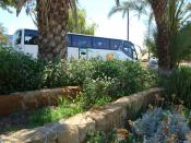 English: Tourists bus in Nicosia Republic of Cyprus next to the old aqueduct