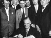 English: United States President signs the TVA Act, which established the . Senator George Norris is on the far right.