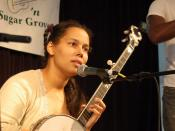 Rhiannon Giddens of Carolina Chocolate Drops with banjo.