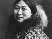 Photograph of an Alaska Native woman wearing a coat with a fur collar. Original title was