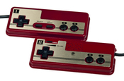 English: The pair of wired controllers that are attached to the Japanese Famicom video game console, made by Nintendo.