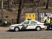English: Police officers watching the traffic for the 2011 Good Friday procession in Riga, Latvia. Svenska: Poliser vakande över trafiken inför Långfredagsprocessionen 2011 i Riga, Lettland.