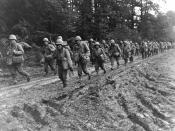 The 442nd Regimental Combat Team, hiking up a muddy French road in the Chambois Sector, France, in late 1944.