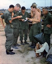 An alleged NLF activist, captured during an attack on an American outpost near the Cambodian border, is interrogated.