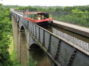 A canal boat traverses the longest and highest aqueduct in the UK, at Pontcysyllte in Denbighshire, Wales