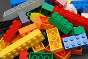 A pile of Lego blocks, of assorted colours and sizes.