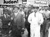 English: During the boycot of Jews on april 1, 1933 in Nazi-Germany jews are forced to march with anti-semitic signs. The men in uniform are SA-members. The signs say things like: