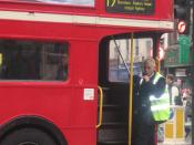 Traditional British open-platform Routemaster bus, operated with a conductor
