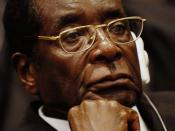 Original caption: President of Zimbabwe Robert Mugabe listens as Prof. Alpha Oumar Konare, chairman of the Commission of the African Union, addresses attendees at the opening ceremony of the 10th Ordinary Session of the Assembly during the African Union S