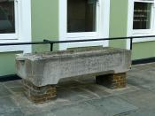 English: Memorial drinking trough The trough is situated outside 1475029 , where it is seen planted with flowers. It has this inscription : In memory of Una MacKenzie who died January 27th 1912 aged 21. She being dead, yet speaketh. Erected by her aunt Fr