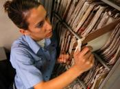 A medical record folder being pulled from the records