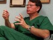 Cropped from a news photo of George Tiller, Dr. Tiller gives a mock consultation in his clinic, Women's Health Care Services, which he owned and operated in Wichita, Kansas from 1975 until his assassination in 2009