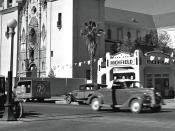 Phoenix, Arizona street in 1939. There were still lots of Model T's in use. Street scene shows parked and moving cars, church, and gas station.