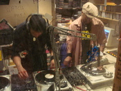 DJ Hypnotize and Baby Cee DJ'ing Flckr By-sa image