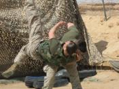 English: Two Marines from 2nd Marine Aircraft Wing (Fwd) practice Marine Corps Martial Arts Program at Al Asad, Iraq. Here, Corporal Robert Lemiszki performs the shoulder throw technique on Corporal Halie Kennie.