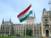 English: A flag from the 1956 Hungarian Revolution on the memorial to the victims located outside the Hungarian Parliament Building