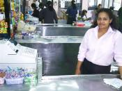 A cashier at her register in a grocery store in Panama.
