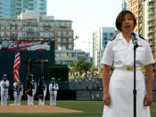 English: SAN DIEGO (July 20, 2009) Lt. Joselyn C. Mercado, an obstetrician/gynecologist resident assigned to Naval Medical Center San Diego, sings the national anthem at Petco Park in San Diego, Calif. before a baseball game between the Padres and the Flo