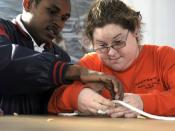 English: YORKTOWN, Va. (Dec. 12, 2008) Boatswain's Mate 2nd Class Jamie Marriott helps a student from the LifeSkills Learning Center tie a square knot. Students from the LifeSkills Learning Center visited the Watermen's Museum to learn basic seamanship fr