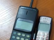 Nokia 150 (large) near Nokia 1100 (small) and lip shine (between them).