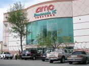 English: AMC Theatres Promenade 16, a 16-auditorium movie theater or multiplex. It is located at Westfield Shoppingtown Promenade, a shopping center in Woodland Hills. Photographed on May 19, 2006 by user Coolcaesar.