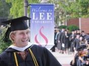 English: A young man graduates from Lee University in 2009.