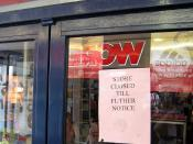 Notice of closure attached to the door of a computer store the day after its parent company declared
