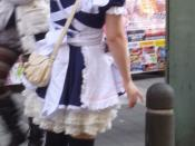English: A woman in a Maid Cosplay uniform advertising a shop. Provided here for if someone wants an image that doesn't show a face, to avoid personal privacy rights. Enjoy! (Don't forget to attribute!)