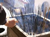 Burning incense sticks at Mount Wutai, China.