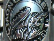 A Mongoose head badge.