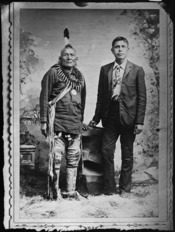 Full length portrait of Indian and white man - NARA - 523715