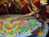 HH Dagchen Sakya draws a line through the Hevajra sand mandala after initiation, holding a gold dorje & ringing a vajra handled bell, three masters of ceremony assist, one monk observes, Sakya Lamdre, Tharlam Monastery Shrineroom, Boudha, Kathmandu, Nepal