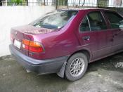 English: maroon nissan sentra philippines