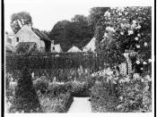 English: View of the gardens at Pavilion Colombe, St. Brice-sous-Forêt, France, with the home of American writer Edith Wharton in the background. Photograph by American photographer Frances Benjamin Johnston. No known restrictions on publication. Johnston