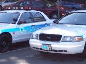 The police car on the right is a slick-top or