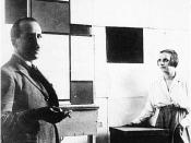 English: Anonymous. Piet Mondrian and Pétro (Nelly) van Doesburg in Mandrian's studio at Rue du Départ, Paris. 1923. Photo. Published (in altered form) in De Stijl, vol. VI, nr. 6/7 (1924): p. 86. Nederlands: Anoniem. Piet Mondriaan en Pétro (Nelly) van D
