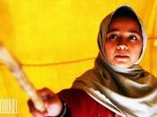 English: Student in Demolished school, studying and reading, Mingora City - Swat, Pakistan