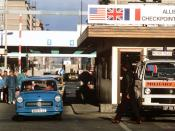 East Germans drive their vehicles through Checkpoint Charlie as they take advantage of relaxed travel restrictions to visit West Germany.