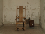 English: Original Death Chamber at the Red Hat Cell Block. The chair is a replica of the original. The Red Hat was closed in the early 1970s.