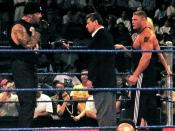 English: From left-to-right: Undertaker (real name Mark Calaway), Vince McMahon, Brock Lesnar and Sable (hidden behind Brock, the blond hair is hers).