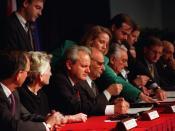 Slobodan Milošević, Alija Izetbegović and Franjo Tuđman signing the Dayton Agreement in Paris on December 14, 1995.