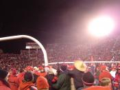 English: Utah Utes fans rush the field and carry the goalpost after defeating rival BYU, completing a perfect regular season, and becoming the first BCS Buster by clinching a spot in the 2005 Fiesta Bowl (hence the sombrero).