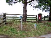 English: Postbox, Windy Corner Postbox and footpath sign near the Memorial at Windy Corner.