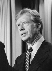 President Jimmy Carter announces new sanctions against Iran in retaliation for taking U.S. hostages