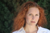 English: Woman with natural red hair