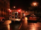English: Ambulance loading the taxi cab driver on Luckie St NW after the tornado.