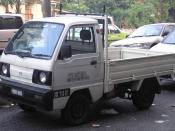 Front-side shot of a fifth generation Suzuki Carry pickup truck in Sentul, Kuala Lumpur, Malaysia.