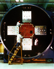 Technicians at the Naval Research Laboratory (NRL), work on the Low-powered Atmosphere Compensation Experiment satellite, which was developed by the NRL as part of its Strategic Defense Initiative (SDI) research. Location: WASHINGTON, DISTRICT OF COLUMBIA