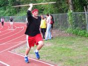 A high school athlete throwing the javelin.