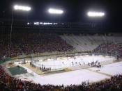 English: 2006 NCAA National Champion Wisconsin Badgers Men's Hockey team defeating the Ohio State Buckeyes Mens Hockey team at an outdoor Hockey game at Lambeau Field - home of the NFL's Green Bay Packers.